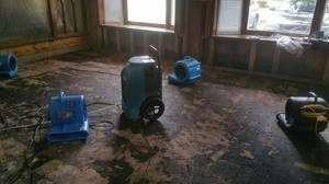Air Movers and Dehumidifiers In Living Room Restoration