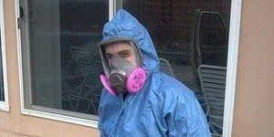 Water Damage Restoration Technician In Full Gear
