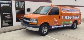 Water Damage Restoration Van Ready At Commercial Job Site